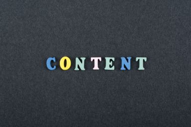 CONTENT word on black board background composed from colorful abc alphabet block wooden letters, copy space for ad text. Learning english concept.